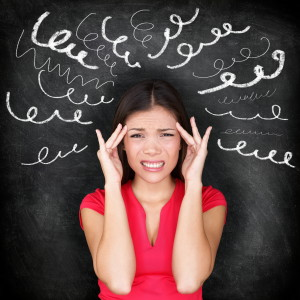 Stress - woman stressed with headache. Female stressed and worri